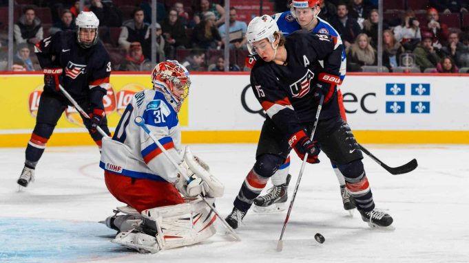 MONTREAL, QC - JANUARY 02: John Hayden #15 of Team United States tries to take a shot on Igor Shesterkin #30 of Team Russia in a quarterfinal round during the 2015 IIHF World Junior Hockey Championships at the Bell Centre on January 2, 2015 in Montreal, Quebec, Canada. Team Russia defeated Team United States 3-2.