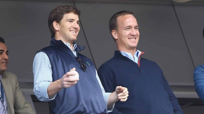 NEW YORK, NY - MAY 04: Eli Manning of the New York Giants and Peyton Manning of the Denver Broncos appear at the game between the New York Yankees and the Tampa Bay Rays on May 4, 2014 in the Bronx borough of New York City.
