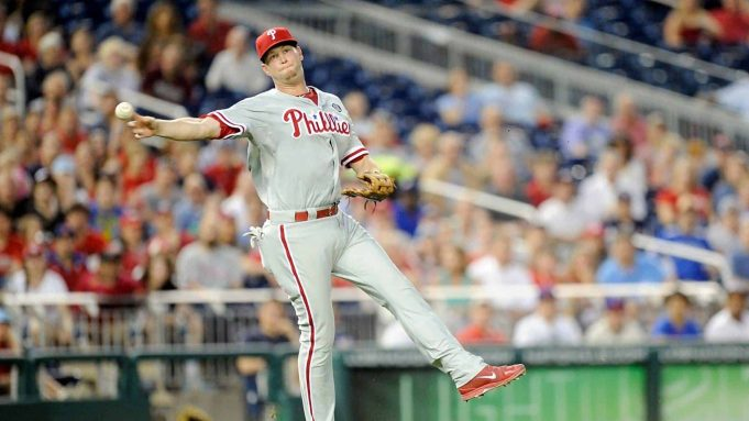 WASHINGTON, DC - JUNE 03: Reid Brignac #17 of the Philadelphia Phillies throws the ball to first base for an out in the fifth inning against the Washington Nationals at Nationals Park on June 3, 2014 in Washington, DC.