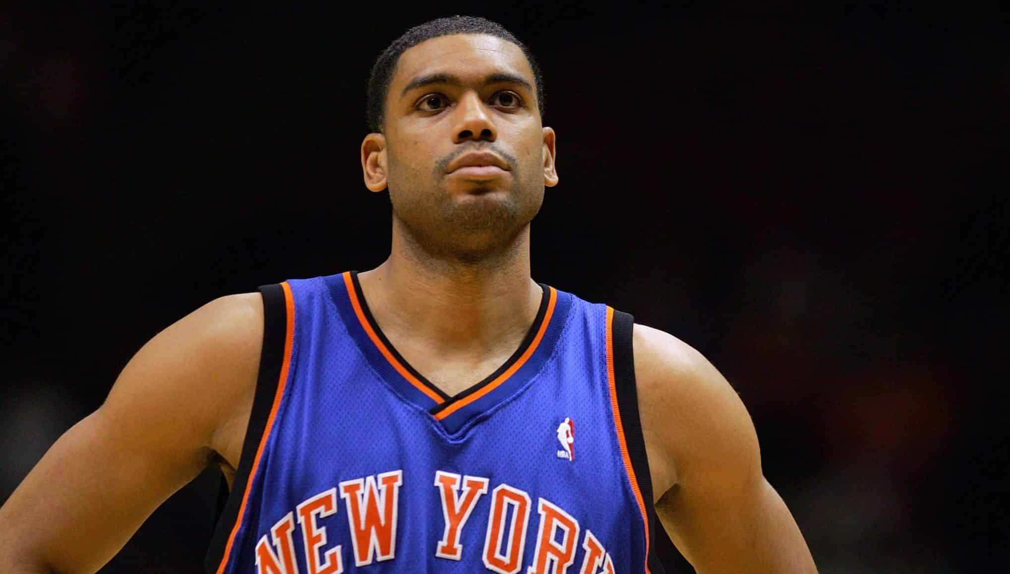 EAST RUTHERFORD, NJ - DECEMBER 14: Allan Houston #20 of the New York Knicks looks on during a game against the New Jersey Nets on December 14, 2004 at Continental Airlines Arena in East Rutherford, New Jersey. The Knicks won 87-79. NOTE TO USER: User expressly acknowledges and agrees that, by downloading and/or using this Photograph, User is consenting to the terms and conditions of the Getty Images License Agreement.