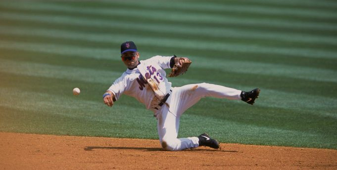 19 Jul 2001: Edgardo Alfonzo #13 of the New York Mets throwing the ball to first base during the game against the Florida Marlins at Shea Stadium in Flushing, New York. The Marlins defeated the Mets 8-3.