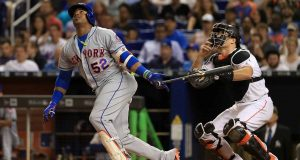 MIAMI, FL - JUNE 29: Yoenis Cespedes #52 of the New York Mets hits during a game against the Miami Marlins at Marlins Park on June 29, 2017 in Miami, Florida.