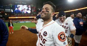HOUSTON, TX - OCTOBER 21: Jose Altuve #27 of the Houston Astros celebrates after defeating the New York Yankees by a score of 4-0 to win Game Seven of the American League Championship Series at Minute Maid Park on October 21, 2017 in Houston, Texas. The Houston Astros advance to face the Los Angeles Dodgers in the World Series.
