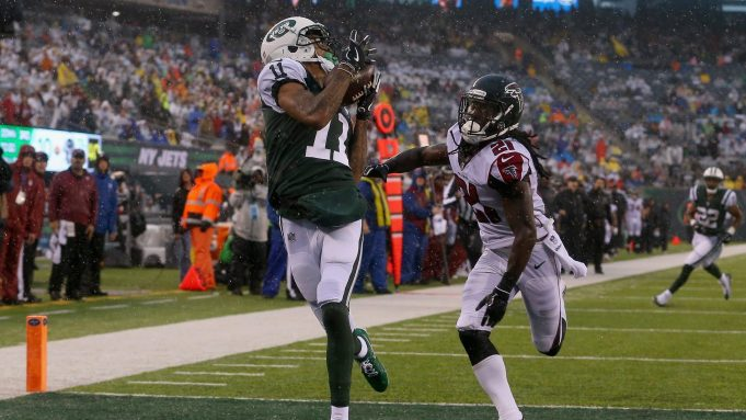 EAST RUTHERFORD, NJ - OCTOBER 29: Wide receiver Robby Anderson #11 of the New York Jets scores a touchdown against cornerback Desmond Trufant #21 of the Atlanta Falcons during the second quarter of the game at MetLife Stadium on October 29, 2017 in East Rutherford, New Jersey.