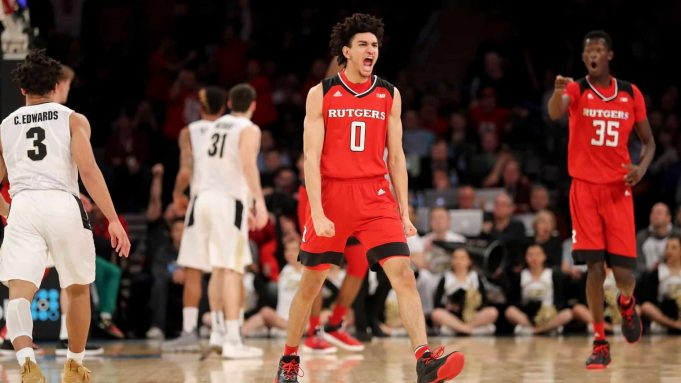 NEW YORK, NY - MARCH 02: Geo Baker #0 of the Rutgers Scarlet Knights reacts in the first half against the Purdue Boilermakers during quarterfinals of the Big Ten Basketball Tournament at Madison Square Garden on March 2, 2018 in New York City.