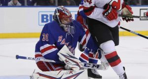 NEW YORK, NEW YORK - SEPTEMBER 18: Igor Shesterkin #31 of the New York Rangers defends the net against Brandon Baddock #34 of the New Jersey Devils during the third period at Madison Square Garden on September 18, 2019 in New York City. The Devils defeated the Rangers 4-3.