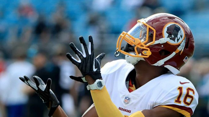 JACKSONVILLE, FLORIDA - DECEMBER 16: Jehu Chesson #16 of the Washington Redskins warms up prior to the game at TIAA Bank Field on December 16, 2018 in Jacksonville, Florida.