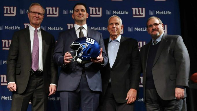 EAST RUTHERFORD, NJ - JANUARY 09: New York Giants new head coach Joe Judge, center, poses for photographs with team CEO John Mara, left, chairman and executive vice president Steve Tisch, and general manager Dave Gettleman, right, after a news conference at MetLife Stadium on January 9, 2020 in East Rutherford, New Jersey.