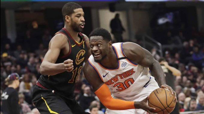 New York Knicks' Julius Randle (30) drives past Cleveland Cavaliers' Tristan Thompson (13) in the second half of an NBA basketball game, Monday, Jan. 20, 2020, in Cleveland. New York won 106-86.