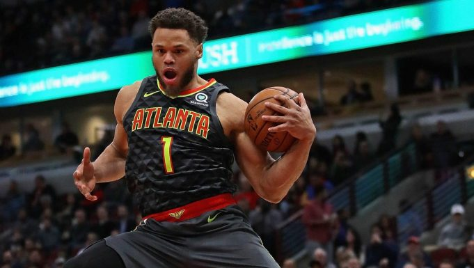 CHICAGO, ILLINOIS - JANUARY 23: Justin Anderson #1 of the Atlanta Hawks leaps to catch a pass against the Chicago Bulls at the United Center on January 23, 2019 in Chicago, Illinois. NOTE TO USER: User expressly acknowledges and agrees that, by downloading and or using this photograph, User is consenting to the terms and conditions of the Getty Images License Agreement.