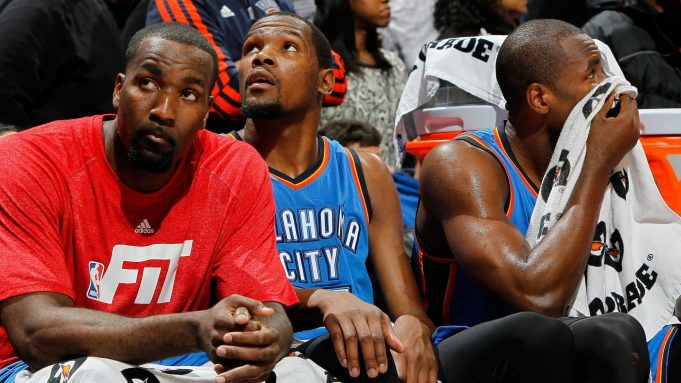 ATLANTA, GA - JANUARY 23: Kendrick Perkins #5, Kevin Durant #35 and Serge Ibaka #9 of the Oklahoma City Thunder sit in the final seconds of their 103-93 loss to the Atlanta Hawks at Philips Arena on January 23, 2015 in Atlanta, Georgia. NOTE TO USER: User expressly acknowledges and agrees that, by downloading and or using this photograph, User is consenting to the terms and conditions of the Getty Images License Agreement.