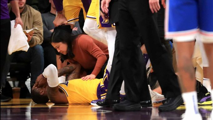 LOS ANGELES, CALIFORNIA - JANUARY 07: Kentavious Caldwell-Pope #1 of the Los Angeles Lakers holds his head after a foul by Bobby Portis #1 of the New York Knicks during the first half of a game at Staples Center on January 07, 2020 in Los Angeles, California. NOTE TO USER: User expressly acknowledges and agrees that, by downloading and/or using this photograph, user is consenting to the terms and conditions of the Getty Images License Agreement