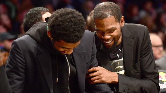 NEW YORK, NEW YORK - NOVEMBER 18: Kyrie Irving #11 and Kevin Durant #7 of the Brooklyn Nets laugh together on the bench during a game against the Indiana Pacers at Barclays Center on November 18, 2019 in the Brooklyn borough of New York City. NOTE TO USER: User expressly acknowledges and agrees that, by downloading and or using this Photograph, user is consenting to the terms and conditions of the Getty Images License Agreement.