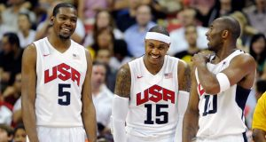 LAS VEGAS, NV - JULY 12: Kevin Durant #5, Carmelo Anthony #15 and Kobe Bryant #10 of the US Men's Senior National Team chat on the sideline during a pre-Olympic exhibition game against the Dominican Republic at Thomas & Mack Center on July 12, 2012 in Las Vegas, Nevada. The United States won the game 113-59.