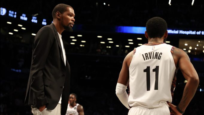 NEW YORK, NEW YORK - JANUARY 18: Kevin Durant #7 of the Brooklyn Nets talks to Kyrie Irving #11 of the Brooklyn Nets during their game against the Milwaukee Bucksat Barclays Center on January 18, 2020 in New York City. NOTE TO USER: User expressly acknowledges and agrees that, by downloading and/or using this photograph, user is consenting to the terms and conditions of the Getty Images License Agreement.