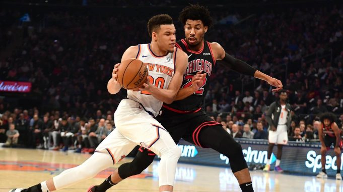 NEW YORK, NEW YORK - OCTOBER 28: Kevin Knox II #20 of the New York Knicks drives against Otto Porter Jr. #22 of the Chicago Bulls in the first half at Madison Square Garden on October 28, 2019 in New York City. NOTE TO USER: User expressly acknowledges and agrees that, by downloading and or using this Photograph, user is consenting to the terms and conditions of the Getty Images License Agreement.