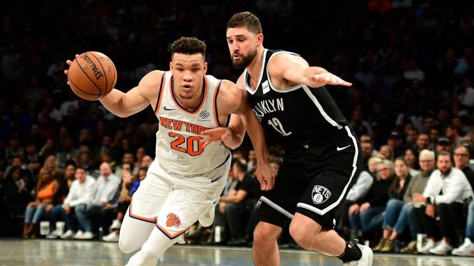 NEW YORK, NEW YORK - OCTOBER 25: Joe Harris #12 of the Brooklyn Nets guards Kevin Knox II #20 of the New York Knicks as he dribbles the ball during the second half of their game at Barclays Center on October 25, 2019 in the Brooklyn borough of New York City. NOTE TO USER: User expressly acknowledges and agrees that, by downloading and or using this photograph, User is consenting to the terms and conditions of the Getty Images License Agreement.