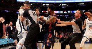 NEW YORK, NEW YORK - JANUARY 29: The referees try to break up a fight between Jae Crowder #99 of the Memphis Grizzlies and Elfrid Payton #6 of the New York Knicks as the benches clear in the final minute of the game at Madison Square Garden on January 29, 2020 in New York City.The Memphis Grizzlies defeated the New York Knicks 127-106.NOTE TO USER: User expressly acknowledges and agrees that, by downloading and or using this photograph, User is consenting to the terms and conditions of the Getty Images License Agreement.