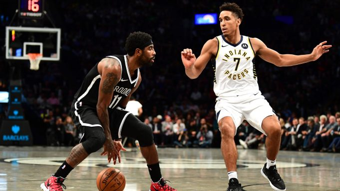 NEW YORK, NEW YORK - OCTOBER 30: Kyrie Irving #11 of the Brooklyn Nets dribbles the ball as Malcolm Brogdon #7 of the Indiana Pacers guards him during the first half of their game at Barclays Center on October 30, 2019 in the Brooklyn borough of New York City. NOTE TO USER: User expressly acknowledges and agrees that, by downloading and or using this Photograph, user is consenting to the terms and conditions of the Getty Images License Agreement.