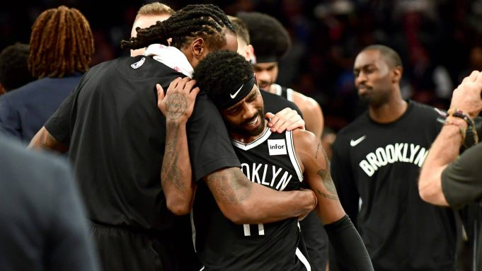 NEW YORK, NEW YORK - OCTOBER 23: DeAndre Jordan #6 hugs Kyrie Irving #11 of the Brooklyn Nets after their 127-126 loss to the Minnesota Timberwolves at Barclays Center on October 23, 2019 in the Brooklyn borough of New York City. NOTE TO USER: User expressly acknowledges and agrees that, by downloading and or using this photograph, User is consenting to the terms and conditions of the Getty Images License Agreement.