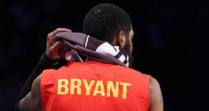 NEW YORK, NEW YORK - JANUARY 29: Kyrie Irving #11 of the Brooklyn Nets wears a Kobe Bryant warmup shirt against the Detroit Pistonsduring their game at Barclays Center on January 29, 2020 in New York City.