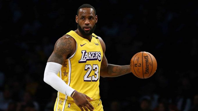 NEW YORK, NEW YORK - JANUARY 23: LeBron James #23 of the Los Angeles Lakers carries the ball against against the Brooklyn Nets at Barclays Center on January 23, 2020 in New York City. NOTE TO USER: User expressly acknowledges and agrees that, by downloading and or using this photograph, User is consenting to the terms and conditions of the Getty Images License Agreement.