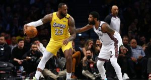 NEW YORK, NEW YORK - JANUARY 23: LeBron James #23 of the Los Angeles Lakers posts up against Kyrie Irving #11 of the Brooklyn Nets at Barclays Center on January 23, 2020 in New York City. NOTE TO USER: User expressly acknowledges and agrees that, by downloading and or using this photograph, User is consenting to the terms and conditions of the Getty Images License Agreement. Mandatory Copyright Notice: Copyright 2020 NBAE.