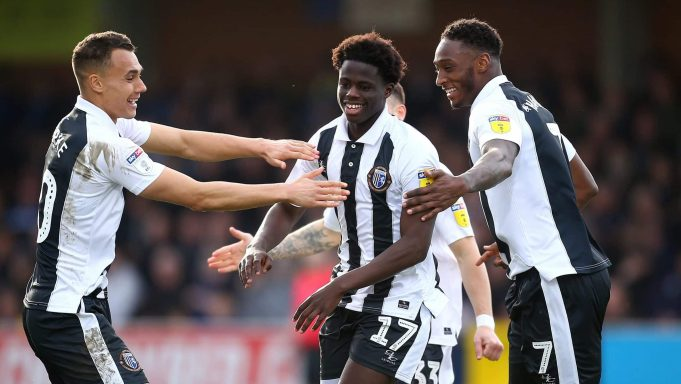 KINGSTON UPON THAMES, ENGLAND - MARCH 23: Leonardo Da Silva Lopes of Gillingham celebrates with his teammates after scoring his sides third goal during the Sky Bet League One match between AFC Wimbledon and Gillingham at The Cherry Red Records Stadium on March 23, 2019 in Kingston upon Thames, United Kingdom.