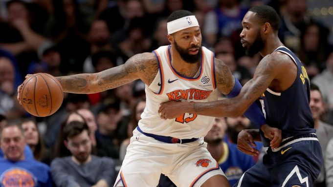 DENVER, COLORADO - DECEMBER 15: Marcus Morris Sr. #13 of the New York Knicks drives against Will Barton III #5 of the Denver Nuggets in the fourth quarter at the Pepsi Center on December 15, 2019 in Denver, Colorado. NOTE TO USER: User expressly acknowledges and agrees that, by downloading and or using this photograph, User is consenting to the terms and conditions of the Getty Images License Agreement.
