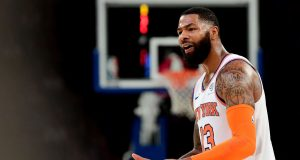 NEW YORK, NEW YORK - OCTOBER 11: Marcus Morris Sr. #13 of the New York Knicks reacts to a call during the third quarter of their game against the Washington Wizards at Madison Square Garden on October 11, 2019 in New York City. NOTE TO USER: User expressly acknowledges and agrees that, by downloading and or using this photograph, User is consenting to the terms and conditions of the Getty Images License Agreement.