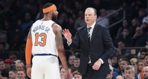 New York Knicks head coach Mike Miller, right, talks to forward Marcus Morris Sr. (13) in the first half of an NBA basketball game against the Philadelphia 76ers, Saturday, Jan. 18, 2020, at Madison Square Garden in New York.
