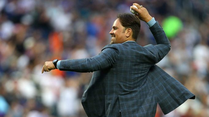 NEW YORK, NY - JUNE 09: Former New York Mets catcher and Hall of Famer Mike Piazza, throws out the first pitch before a game between the New York Yankees and New York Mets at Citi Field on June 9, 2018 in the Flushing neighborhood of the Queens borough of New York City.