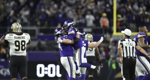 MINNEAPOLIS, MN - JANUARY 14: Case Keenum #7 of the Minnesota Vikings celebrates with teammate Mike Remmers #74 after completing a 61 yard touchdown pass to win the NFC Divisional Playoff game against the New Orleans Saints on January 14, 2018 at U.S. Bank Stadium in Minneapolis, Minnesota. The Vikings defeated the Saints 29-24.