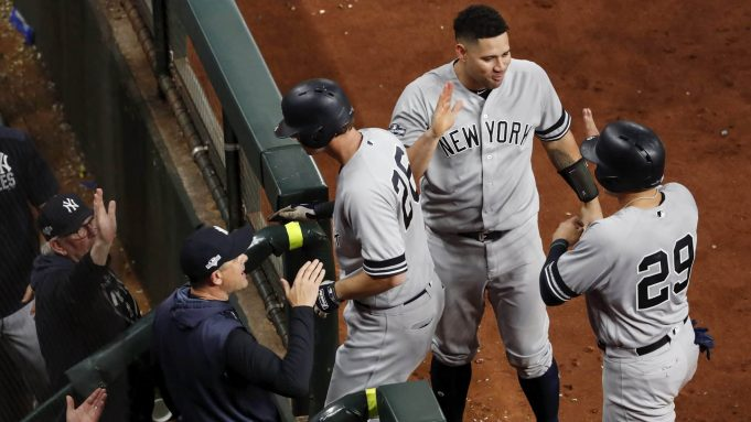 HOUSTON, TX - OCTOBER 19: DJ LeMahieu #26 of the New York Yankees is congratulated in the dugout after a home run in the ninth inning against the Houston Astros during Game Six of the League Championship Series at Minute Maid Park on October 19, 2019 in Houston, Texas.