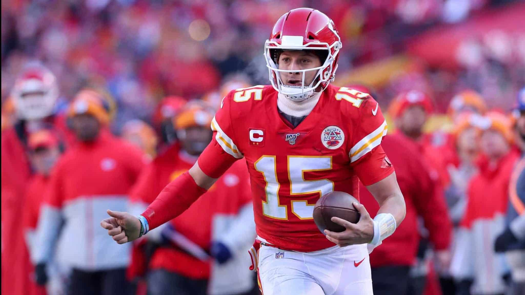 KANSAS CITY, MISSOURI - JANUARY 19: Patrick Mahomes #15 of the Kansas City Chiefs runs on his way to scoring a 27 yard touchdown in the second quarter against the Tennessee Titans in the AFC Championship Game at Arrowhead Stadium on January 19, 2020 in Kansas City, Missouri.