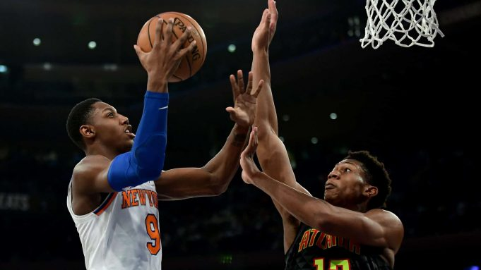 NEW YORK, NEW YORK - DECEMBER 17: RJ Barrett #9 of the New York Knicks drives toward the basket past De'Andre Hunter #12 of the Atlanta Hawks during the second half of their game at Madison Square Garden on December 17, 2019 in New York City.