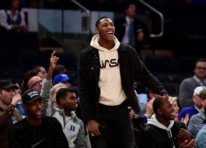 NEW YORK, NEW YORK - NOVEMBER 21: RJ Barrett, a New York Knicks player and Duke Blue Devils alumni, cheers during the Duke Blue Devils and California Golden Bears game at Madison Square Garden on November 21, 2019 in New York City.