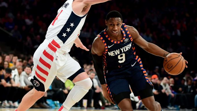 NEW YORK, NEW YORK - DECEMBER 23: RJ Barrett #9 of the New York Knicks drives past Garrison Mathews #24 of the Washington Wizards during the second half of their game at Madison Square Garden on December 23, 2019 in New York City. NOTE TO USER: User expressly acknowledges and agrees that, by downloading and or using this photograph, User is consenting to the terms and conditions of the Getty Images License Agreement.
