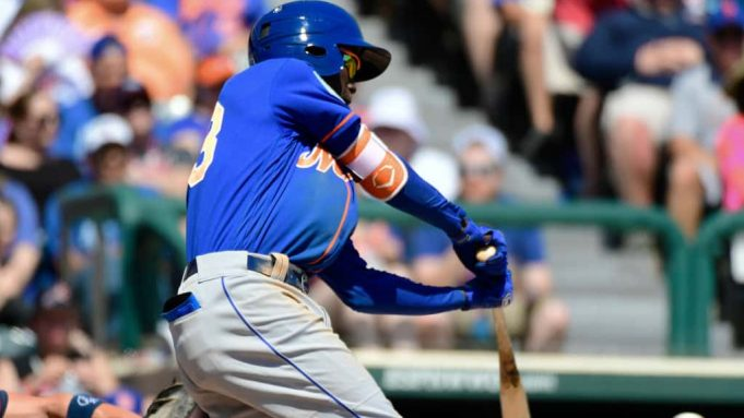 LAKE BUENA VISTA, FLORIDA - MARCH 23: Ronny Mauricio #83 of the New York Mets hits a 2-RBI single in the fifth inning against the Atlanta Braves during a spring training game at Champion stadium on March 23, 2019 in Lake Buena Vista, Florida.