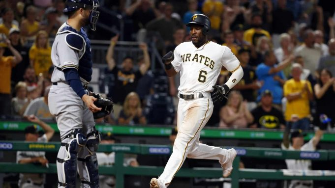PITTSBURGH, PA - AUGUST 06: Starling Marte #6 of the Pittsburgh Pirates scores on an RBI double in the sixth inning against the Milwaukee Brewers at PNC Park on August 6, 2019 in Pittsburgh, Pennsylvania.