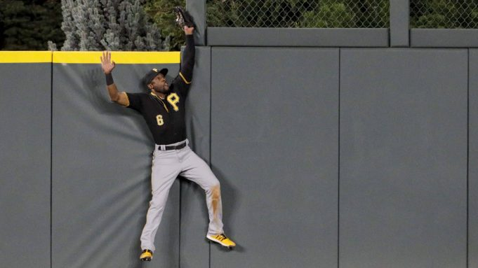 DENVER, CO - AUGUST 29: Starling Marte #6 of the Pittsburgh Pirates catches a fly ball off the bat of Nolan Arenado of the Colorado Rockies to end the fifth inning at Coors Field on August 29, 2019 in Denver, Colorado.
