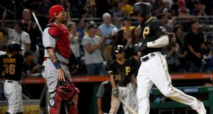 PITTSBURGH, PA - SEPTEMBER 06: Starling Marte #6 of the Pittsburgh Pirates comes around to score in front of Yadier Molina #4 of the St. Louis Cardinals in the seventh inning during the game at PNC Park on September 6, 2019 in Pittsburgh, Pennsylvania.