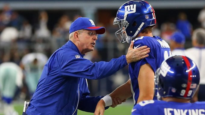 ARLINGTON, TX - SEPTEMBER 13: (L-R) Head coach Tom Coughlin of the New York Giants greets Eli Manning #10 before a game against the Dallas Cowboys at AT&T Stadium on September 13, 2015 in Arlington, Texas.