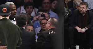 FILE - At left, in a Feb. 8, 2017, file photo, former New York Knicks player Charles Oakley, rear left, exchanges words with a security guard during the first half of an NBA basketball game between the Knicks and the Los Angeles Clippers, in New York. At right, also in a Feb. 8, 2017, file photo, Madison Square Garden Executive Chairman James Dolan watches the altercation. Oakley has sued the team's owners, saying he was defamed when they claimed he committed assault and was an alcoholic. The lawsuit details how Oakley was treated before and after he was forcefully removed from Madison Square Garden during a Feb. 8 game. The lawsuit filed Tuesday, Sept. 12, 2017, seeks unspecified damages.