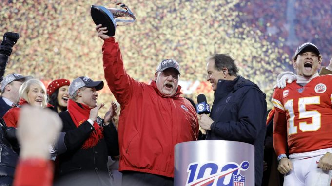Kansas City Chiefs owners, Norma Hunt, left, her son Clark Hunt, second from left, and quarterback Patrick Mahomes, right, look on as Kansas City Chiefs head coach Andy Reid, center, holds up the Lamer Hunt Trophy as they celebrate winning the NFL AFC Championship football game against the Tennessee Titans Sunday, Jan. 19, 2020, in Kansas City, MO. The Chiefs won 35-24 to advance to Super Bowl 54.