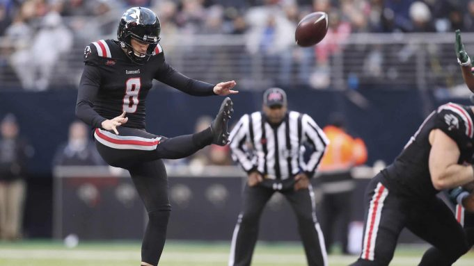 New York Guardians punter Justin Vogel (8) punts the ball away during an XFL football game against the Tampa Bay Vipers, Sunday, Feb. 9, 2020, in East Rutherford, N.J. The New York Guardians won 23-3.