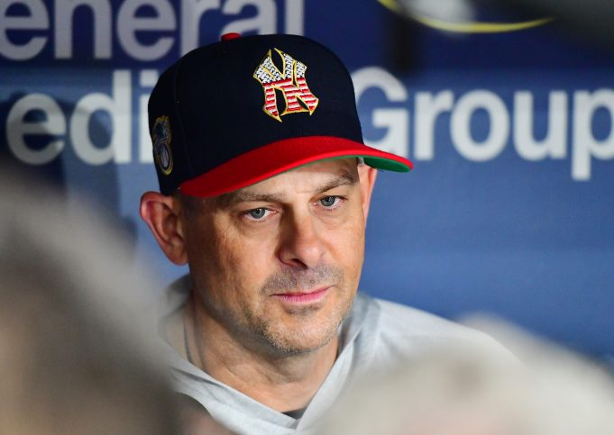 ST. PETERSBURG, FLORIDA - JULY 04: Manager Aaron Boone #17 of the New York Yankees answers questions from reporters before a baseball game against the Tampa Bay Rays at Tropicana Field on July 04, 2019 in St. Petersburg, Florida.