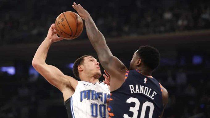New York Knicks forward Julius Randle (30) blocks the shot of Orlando Magic forward Aaron Gordon (00) during the first half of an NBA basketball game, Thursday, Feb. 6, 2020, in New York.