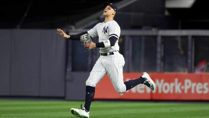 NEW YORK, NEW YORK - OCTOBER 18: Aaron Judge #99 of the New York Yankees chases down a hit by Jose Altuve #27 of the Houston Astros during the third inning in game five of the American League Championship Series at Yankee Stadium on October 18, 2019 in New York City.
