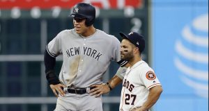 HOUSTON, TEXAS - APRIL 08: Aaron Judge #99 of the New York Yankees and Jose Altuve #27 of the Houston Astros during a break in play in the seventh inning at Minute Maid Park on April 08, 2019 in Houston, Texas.